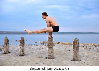 Man Yogi Makes A Stand On His Hands