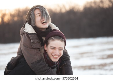 A man and young woman having fun and laughing. Winter