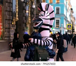 a man in a zebra costume