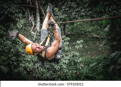 Man zipline flight in jungle