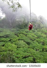 a man ziplines through the cloud forest of Monteverde, Costa Rica