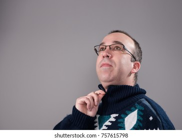 Man zipping up his sweater with room for your text in the background.