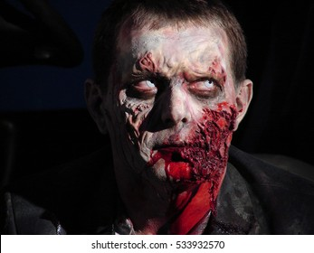 Man with zombie make up face shot