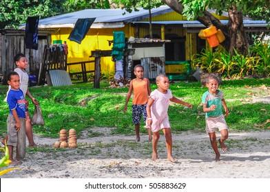 MANA ISLAND, FIJI - AUGUST 20, 2012: Kids playing together in a local village in Mana Island, Fiji