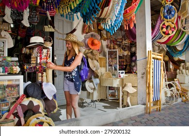 MANABI, ECUADOR - JUNE 1, 2012: Unidentified happy female tourist in a handcraft market in Montecristi, Ecuador
