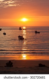 MANABI, ECUADOR - JUNE 3, 2012: Magnificent orange sunset seen from the shore of a fisherman town in Manabi.