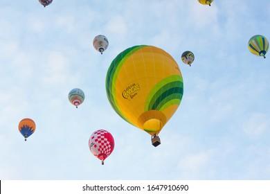 Manacor, Mallorca, Spain - October 27, 2019:  FAI European Hot Air Balloon Championship in Spain. Lots of hot air balloons in the air