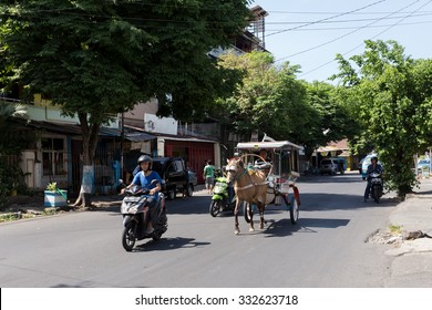 MANADO, NORTH SULAWESI, INDONESIA - AUGUST 5, 2015: Horse drawn carriage in the streets of Manado on August 5, 2015 in Manado, North Sulawesi, Indonesia