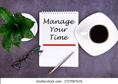 Manage your Time text concept written in a notebook with pen and a cup of coffee, top view.
