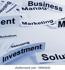 management concept with business elements on sheets of paper