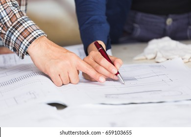 Management consulting engineers foreman working blueprint stock management consulting or engineer and labor woman working with blueprint and drawing on work table in malvernweather Image collections