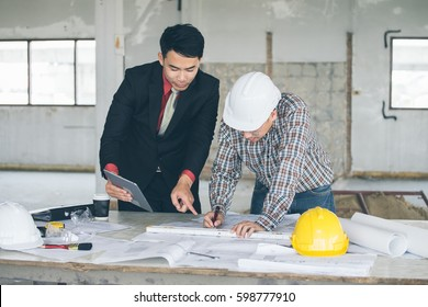 Management consulting engineers foreman working blueprint stock management consulting with engineers working with blueprint and drawing on work table in for management business malvernweather Image collections