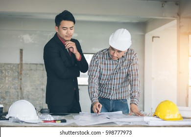 Management consulting engineers working blueprint drawing stock management consulting with engineers working with blueprint and drawing on work table in for management business malvernweather Choice Image