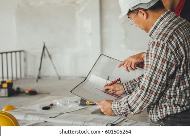 Management Consulting With Engineers Working Blueprint And Drawing On Work Table In For Business