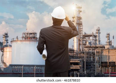 Management consulting with engineers working and holding blueprint engineer designer with helmet holding blueprint in his hand for management business plan.