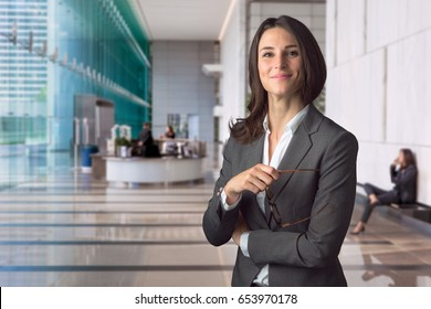 Management staff member with big warm smile happy genuine positive attitude as company employee