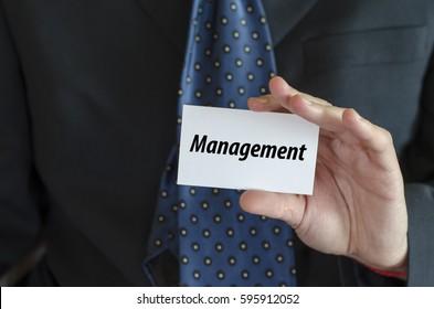 Management text note concept over businessman background