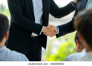 Manager announces award to staff, handshake with winner to congrats his high performance, Teamwork achievement. Trust capacity of availability to deal, contract a business with partner permission.