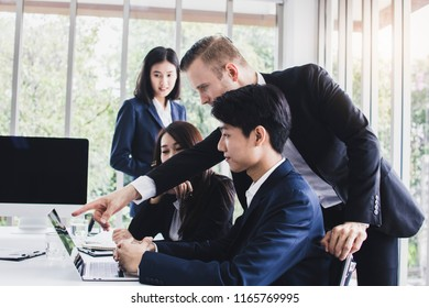 Manager or boss looking at work and admire by showing thumb for good job and successful working in meeting room.