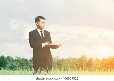Manager, Business man in the middle of a meadow in suit.