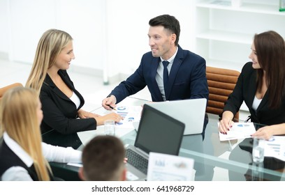 Manager of the company holds a working meeting before the business