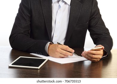 manager at desk writes on the paper phone isolated on white background