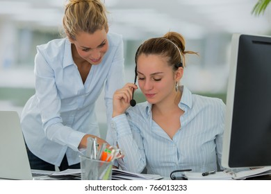 manager and employee in office working together as a team