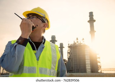 Manager Engineering in standard safety uniform working in gas turbine electric power plant  during sunset or morning time background