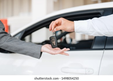 Manager gives woman key to the new car in showroom