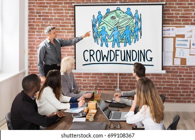 Manager Giving Crowdfunding Concept Presentation To His Team