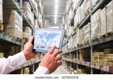 manager hand holding tablet with AR application for check order pick time in smart factory warehouse,  connection for Logistic Import Export ,interior of warehouse. Rows of shelves with boxes