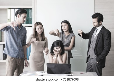Manager and her team complaining to business woman by pointing to him for mistake work.