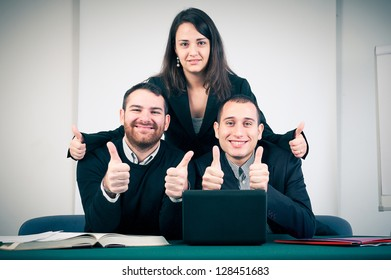 Manager and his team with thumbs up in the office,Italy