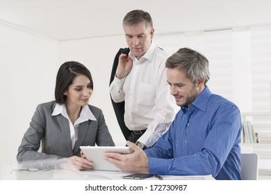 manager and his workteam at office