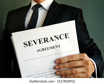 Manager is holding Severance Agreement papers.