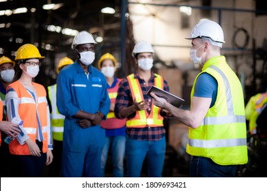 The manager leader team is assignmenting job, training for technicians, supervisor, engineers In the morning meeting before work which everyone wear masks to prevent the coronavirus and safety working - Shutterstock ID 1809693421