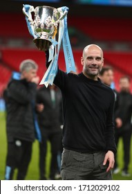 Manager of Manchester City, Pep Guardiola celebrates with the Carabao Cup Trophy - Aston Villa v Manchester City, Carabao Cup Final, Wembley Stadium, London, UK - 1st March 2020