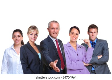 A manager offering to shake your hand with a business team behind, isolated on a white background.