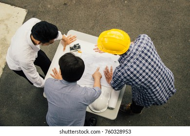 Construction worker pointing up stock photos images photography manager pointing up a blueprint at construction site malvernweather Images