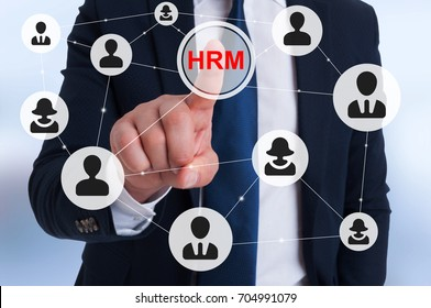 Manager pointing on HRM sign on virtual screen with people icons linked as network