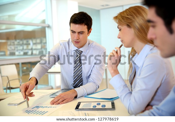 Manager presenting budget to marketing people