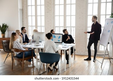 Manager presenting sales report to office colleagues. Leader giving presentation to employees at corporate meeting. Business coach training staff. Workshop, presentation concept