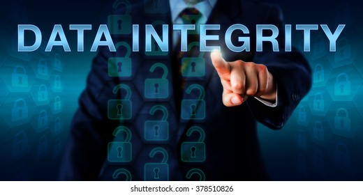 IT manager is pushing DATA INTEGRITY onscreen. Technology and business concept. Self-repeating datasets represented by locked hexagon icons refer to the assurance of accuracy and consistency of data.