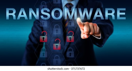 Manager is pushing RANSOMWARE on a touch screen. Three opened lock icons light up in a hexagonal code structure signifying an infected computer system or application. Security technology concept.