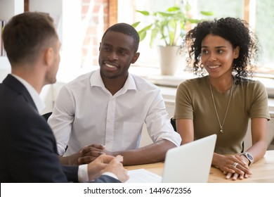 Manager, realtor, insurer consulting clients, smiling African American couple, happy black wife and husband taking loan, mortgage, purchasing real estate, bank worker making offer to customers