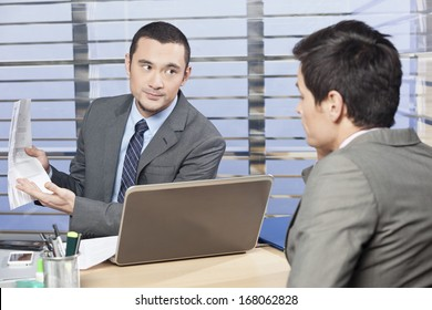 Manager reviewing workers job performance