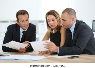 Manager with sales team meeting in office