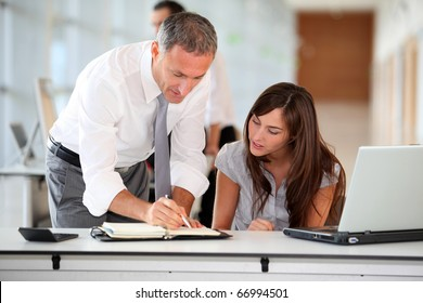 Manager and secretary working in the office
