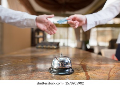 manager serves customers at the hotel