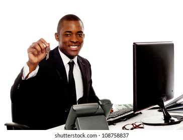 Manager showing office keys to camera isolated against white background
